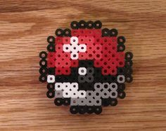 Handmade Perler Pokeball magnet, 2 1/2 inches in diameter. Thank you for visiting our shop and be sure to like us on Facebook!! https://www.facebook.com/soultwinsprites