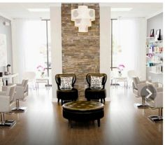 Yaaaaassss...I love the exposed brick, the leather chairs and the white...that should be a retail/ waiting area not the actual salon.