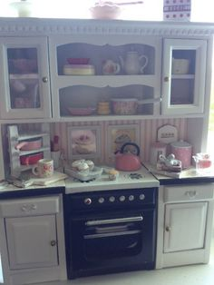 Miniature filled cottage cabinet  unit with stove