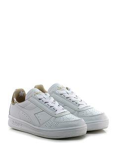 DIADORA Heritage - Sneakers - Donna - Sneaker in pelle e pelle laminata con suola in gomma, tacco 40, platform 25 con battuta 15. - WHITE\GOLD - € 170.00