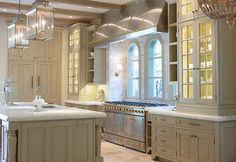 French Kitchen. French Kitchen Design. French Kitchen with La Cornue Range and French Limestone Flooring. #Kitchen #FrenchKitchen #FrenchLimestoneFloors #LaCornue Mobili Martini
