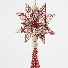 12844 A Woven Star with a Tassel
