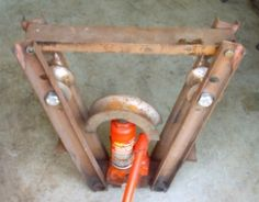 Pipe Bender - Homemade pipe bender constructed from channel, dies, a bottle jack, and nuts and bolts.