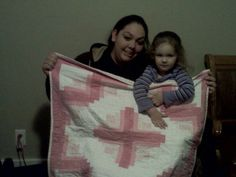 Baby H and mom with log cabin cross quilt