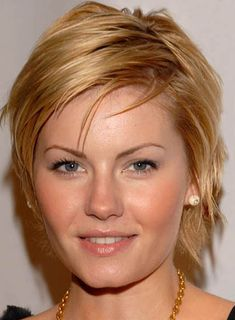 Elisha Cuthbert's sleek, short and sassy hairstyle is perfect for round faces.