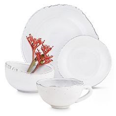 the organic pattern on these 16 cool, white glazed terracotta dinnerware pieces from the monterey collection is inspired by the california coastline.
