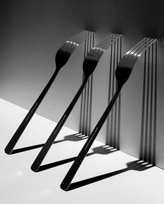 An image we're inspired by: architectural cutlery captured by Darek Grabus. #photography #fork #shadow #light