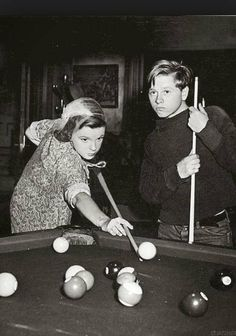 Judy Garland and Mickey Rooney--I love to play pool. I'd like to play with these two. :)