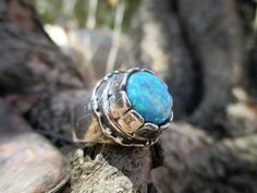 From Porans New collection ----> Unique Sterling Silver Ring. 1 top spinning opal (12 mm). beautiful and fun to wear :)  Dimensions: Max Width:0.72 inches Height: 0.33 inches. Can be any size you need. available with many other stones!  Please contact me for any question.  VISIT our silver watches shop: http://www.etsy.com/shop/PoransWatches  our jewelry shop on Etsy: http://www.etsy.com/shop/Porans  Thank you for Visiting Our shops