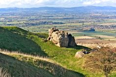 The Elephant stone on Bredon Hill with views to the Malvern Hills