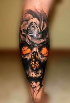 Realistic rose and skull tattoo done by Riccardo Cassese