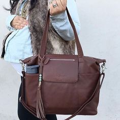 """""""Worth it!!! This is the only diaper bag I will ever use! Love this bag. 5 stars!"""" - Erin Click to purchase the Madeline in Brandy today!"""