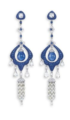 A PAIR OF SAPPHIRE, DIAMOND AND SEED PEARL EAR PENDANTS, BY CARNET EACH SET WITH A SAPPHIRE DROP WITH A CIRCULAR ROSE-CUT DIAMOND CAP, WITHIN A STYLIZED FRAME PAVé-SET WITH CIRCULAR-CUT SAPPHIRES, SUSPENDED FROM A LINE OF FLORAL MOTIFS SET WITH DIAMOND ROUNDEL PETALS AND CIRCULAR-CUT SAPPHIRE PISTILS AND SPACERS, TERMINATING IN A FRINGE OF CIRCULAR AND PEAR-SHAPED ROSE-CUT DIAMONDS AND SEED PEARL TASSELS, MOUNTED IN TITANIUM AND 18K WHITE GOLD, 9.8 AND 10.2 CM LONG