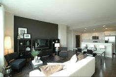 Apartment living room idea - I like the chairs on either side of the tv!