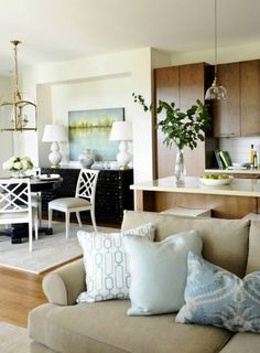 black and white with neutrals and the addition of blue keep this room interesting.