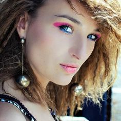 Girl wearing 80s make-up and crimped hair
