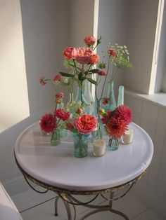 "Tiny bud vases and tea lights around mason jar centerpiece?  Varying jar sizes - blue and ""coral"""