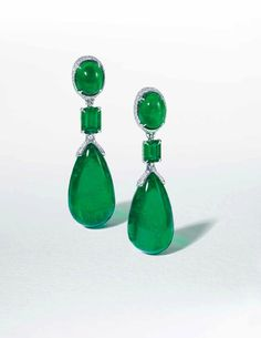 An exceptional pair of emerald ear pendants | Each set with an emerald drop ... suspended from a cabochon emerald ... and a rectangular-cut diamond spacer, to the single-cut diamond gallery, mounted in gold ... With maker's mark for Etcetera