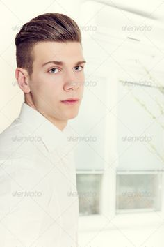 male model with modern haircut posing ...  adult, attractive, background, beautiful, beauty, blond, boy, casual, caucasian, cheerful, closeup, confident, cool, face, fashion, fresh, gorgeous, guy, hair, haircut, hairstyle, handsome, health, lifestyle, look, looking, macho, male, man, men, model, modern, natural, one, perfect, person, portrait, posing, sensual, serious, sexy, skin, smart, student, style, stylish, thoughtful, trendy, white, young