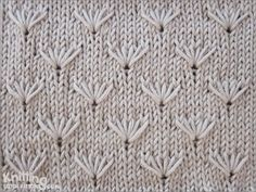 Field of Dandelion flowers . Knit loops 3 stitches below