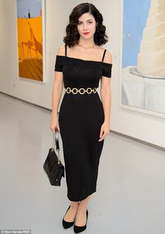 Chic: Marina Diamandis of Marina and the Diamonds wore a sophisticate black off the should...
