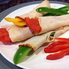 Turkey-Pepper Roll Ups Instead of the traditional carb-heavy wrap, these roll-ups use protein-packed turkey as the base. Wrap the turkey around a few colorful bell pepper sticks for a blast of vitamin C-rich produce, and zest things up by adding a drizzle of mustard or hot sat sauce down the center.