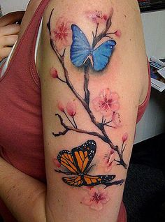Cherry blossom and butterfly tattoo.