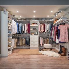 A white closet is a perfect backdrop to showcase your colorful clothes. #MasterCloset #BedroomCloset #HomeOrganization