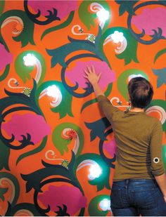 Living Wall - Leah Buechley embedded wallpaper with conducive paints. When people interact with the wallpaper, it lights up.