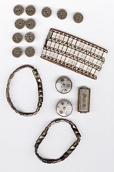 Steampunk bronze components. top left: bronze-toned 'centipede spiral' buttons based on Native American designs (source local fabric warehouse.) Bottom left and bottom: bracelets, bronze-toned square pyramid double-hole beads on elastic. Upper right: bracelet, pewter and copper-toned interlocking metal links on elastic (all three bracelets from Goodwill.) Lower right: Three bronze, brass, and silver-toned screw-on leather/clothing conchos (Tandy Leather).