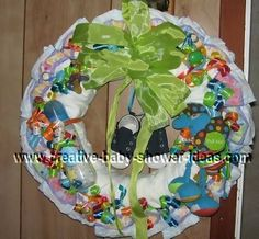 baby wreath...great site with lots of baby shower wreaths with tutorials.
