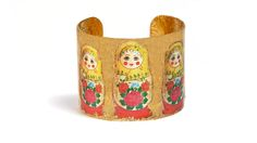 Beautiful Russian Dolls Cuff by Evocateur. THE STORY The first Russian nested doll set—known as the Matroyshka doll—was carved around 1890. Antiqued with 22 karat gold leaf and clear enamel, this exquisite cuff looks like one of Vasily Zvyozdochkin's originals with its vintage detailing.
