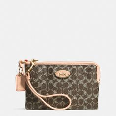 The Corner Zip Wristlet In Embossed Signature Canvas from Coach