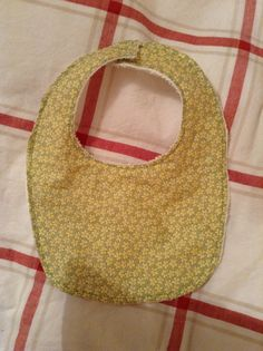 Baby bib using purl soho bib pattern with liberty tana lawn in speckle  and cotton terry towelling reverse with press stud fastening