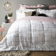 Simple, stylish and sophisticated – you can't go wrong with our new Emira bedding! 💕 This high-thread-count bedding collection feels as luxe as it looks and will enhance your sleep as well as your décor. For a change of scenery, the minimalist grey and white printed front reverses to a plain blush pink. So chic! 💗 Cotton Bedding Sets, Bedding Collections, Grey And White, Blush Pink, Comforters, Count, Scenery, Feels, Minimalist