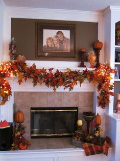 I like the fall garland and the pumpkins a top wooden candlesticks
