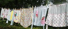 more washed aprons drying on line.