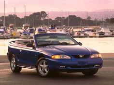 1998 Ford Mustang GT convertible. Except mine is a beautiful dark purple! :)