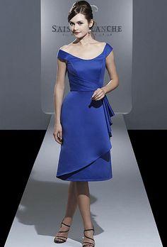 Brides.com: Blue Bridesmaid Dress: Saison Blanche Bridesmaids. A-line, off-the-shoulder dress with asymmetric pleat details.