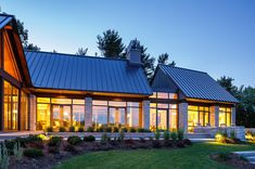 Fabulous metal roof with expansive windows by Astro Design Centre