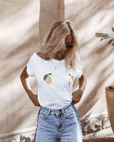 White t shirt with pears over the nipple two toned high waisted denim jeans blonde waves summer tan street style women