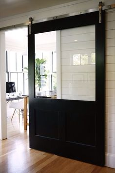 HouseTour:ModernFarmhouse - Design Chic A sliding barn door with a window! I like that you can see the view with the doors closed. Style At Home, Style Blog, Glass Barn Doors, Barn Door With Window, Wood Doors, The Doors, Entry Doors, Patio Doors, Deco Design