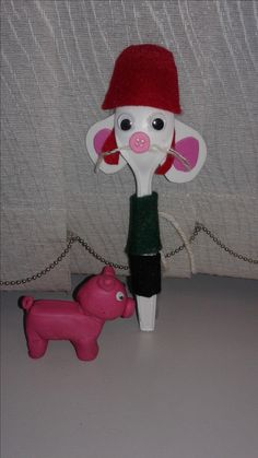 Desperaux (the mouse) and Mercy Watson (pig)! Made with a white plastic spoon, green and black felt, white string, google eyes, white and pink foam, red felt and a pink button. Mercy is made with pink clay!
