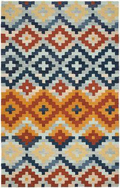 A gold, blue & terra-cotta rug --- living room? nursery? future little boys room?