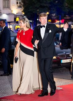 Gracious: The royal couple waved to supporters as they made their way inside the building...