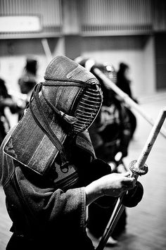 Kendo matches take place in an area 9 to 11 m (about 30 to 36 feet) square. Contestants wear the traditional uwagi (jacket), hakama (long divided skirt), do (chest protector), tare (waist protector), men (mask), and kote (padded gloves).