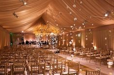 Stunning! The soft pink uplights compliment this #tent #wedding beautifully…