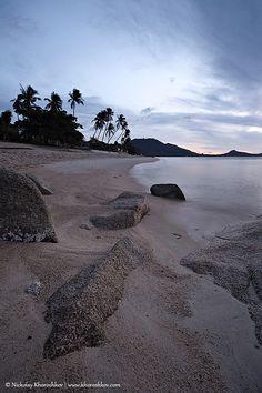 Cloudy sunrise at tropical beach rocky coast