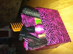 """Turn an old beverage carton into a unique hair beauty organizer. I used a Winecooler 6pack carton because it was the right hight to hold brushes and spray bottles and stuff. Then I covered the outside with my daughter's favorite duct tape in the fabulous pink and black zebra print because this is for her room. I wish I could show a """"before"""" picture! ~~Stay Fabulous!!!"""