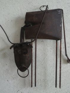 Picasso Cow - $125 -- sold for $150. Metal cow sculpture is made of random pieces of scrap metal and shovels by a Poor Man's Bronze artist. Beautiful home accent piece and metal wall art decor. Recycled garden or yard art.